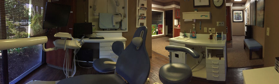 An examination room with a dental chair